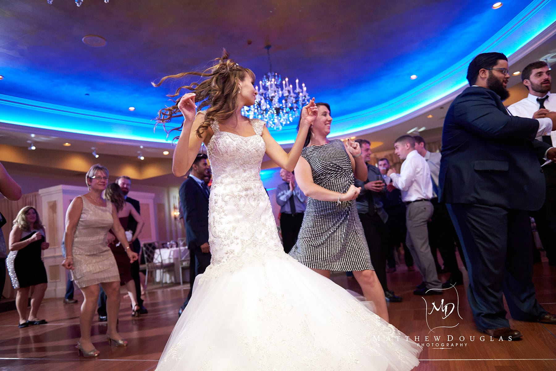 bride dancing at the farmhouse at the grand colonial