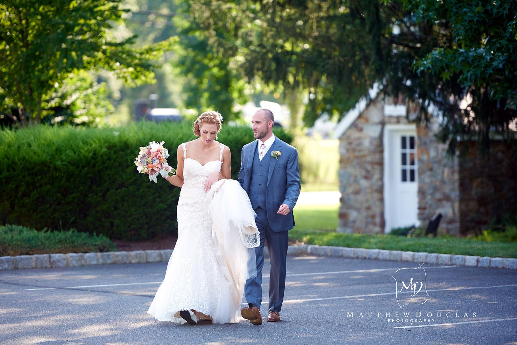 groom walks his bride from the school house at The Farmhouse at The Grand Colonial