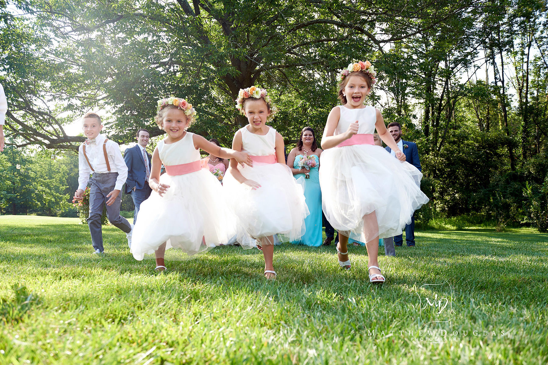 flower girls running at a wedding at The Farmhouse at The Grand Colonial