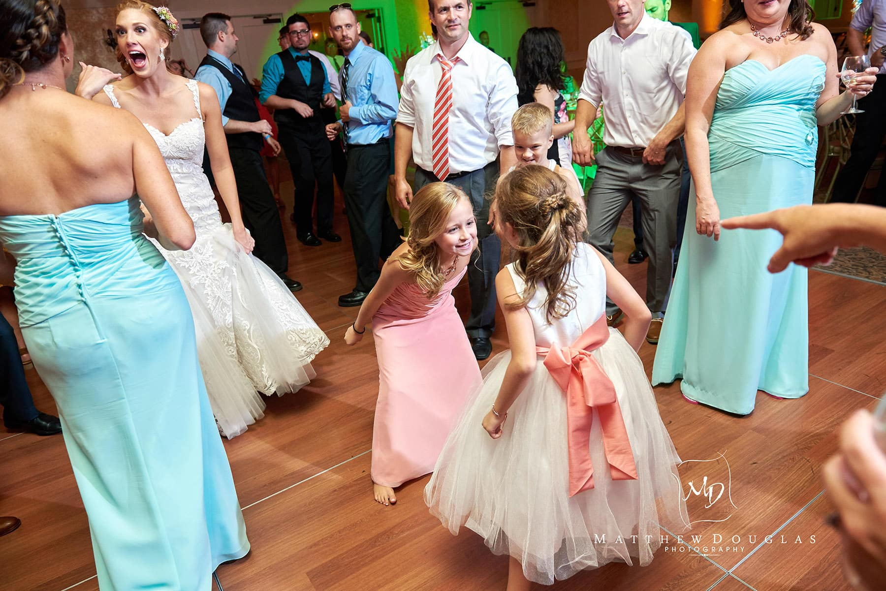 flower girls on the dancefloor at The Farmhouse at The Grand Colonial