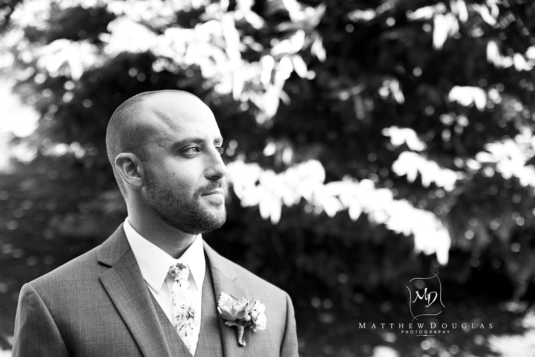 pensive groom before the first look at The Farmhouse at The Grand Colonial