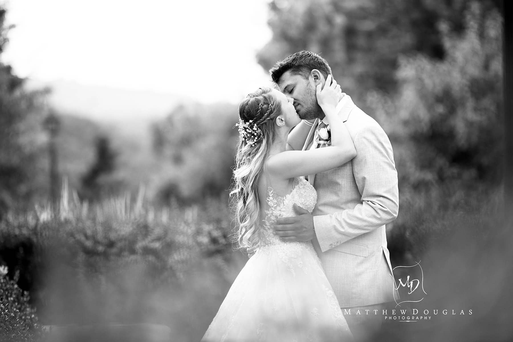 bride and groom share a kiss on their wedding day at the farmhouse at the grand colonial