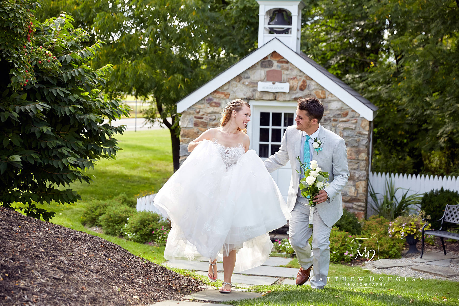 candid bride and groom during their wedding photos at the farmhouse at the grand colonial