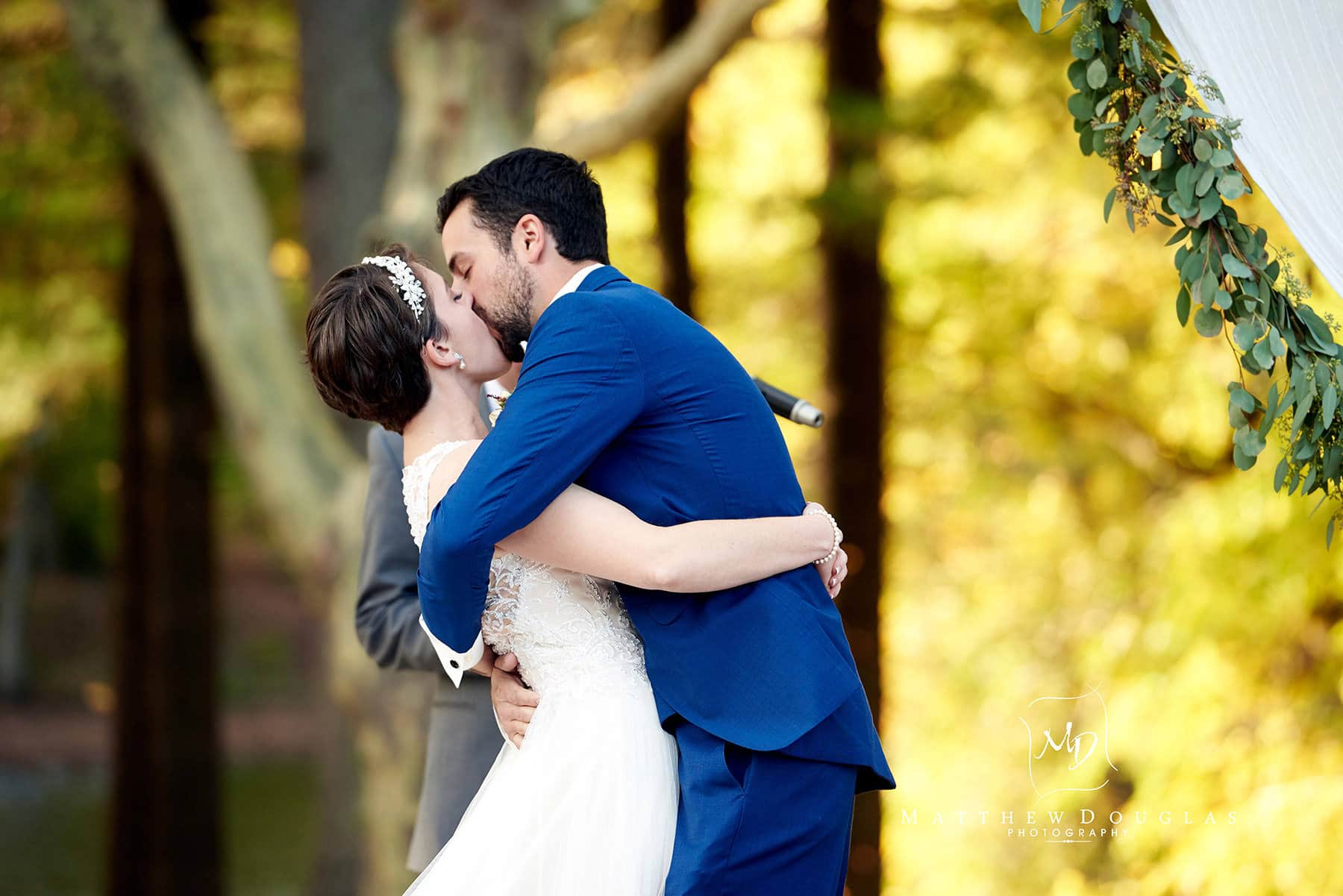 first wedding kiss at The Estate at Farrington Lake