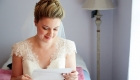 bride reading letter from groom photo