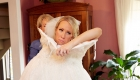 funny bride getting dressed photo