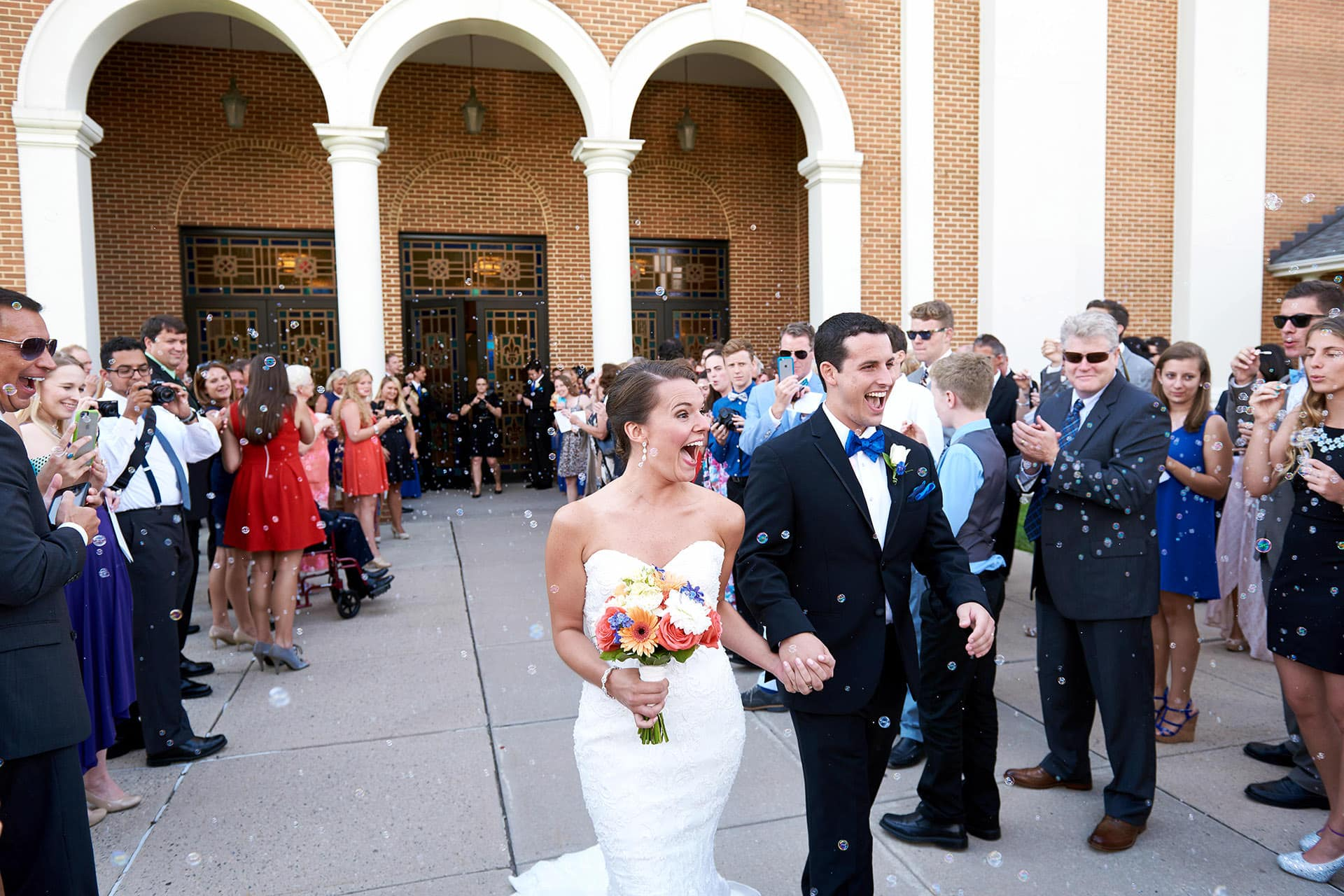 bride + groom leaving church wedding photo
