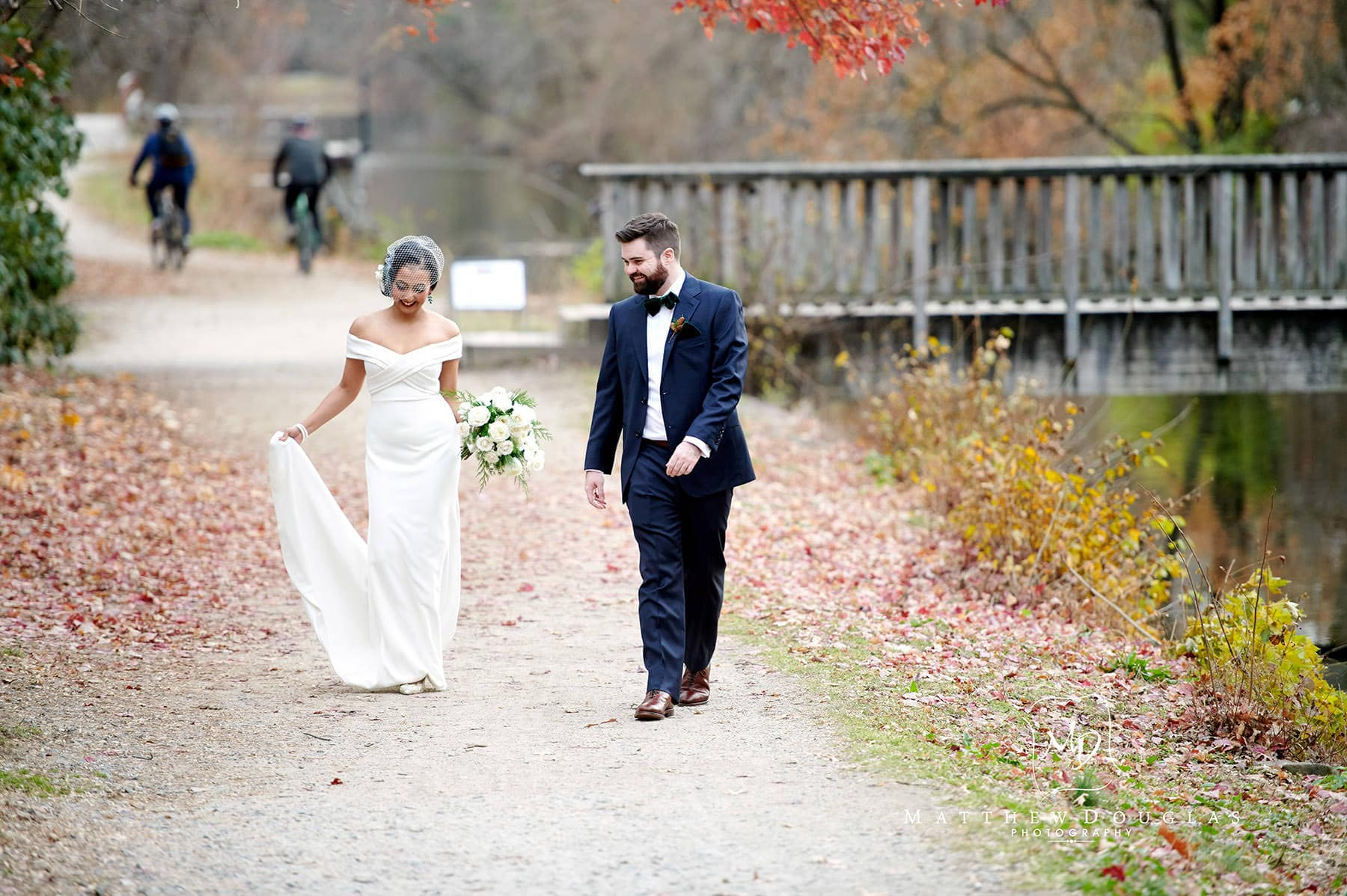 bride and groom walking on the lambertville towpath photo