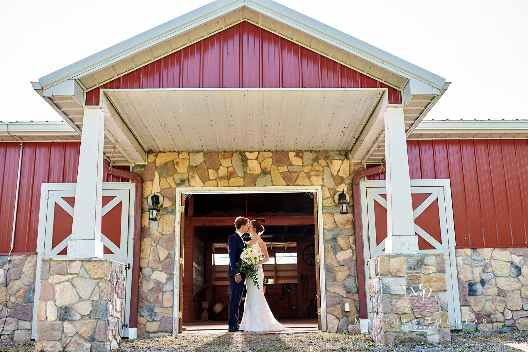 bride and groom in a barn photo