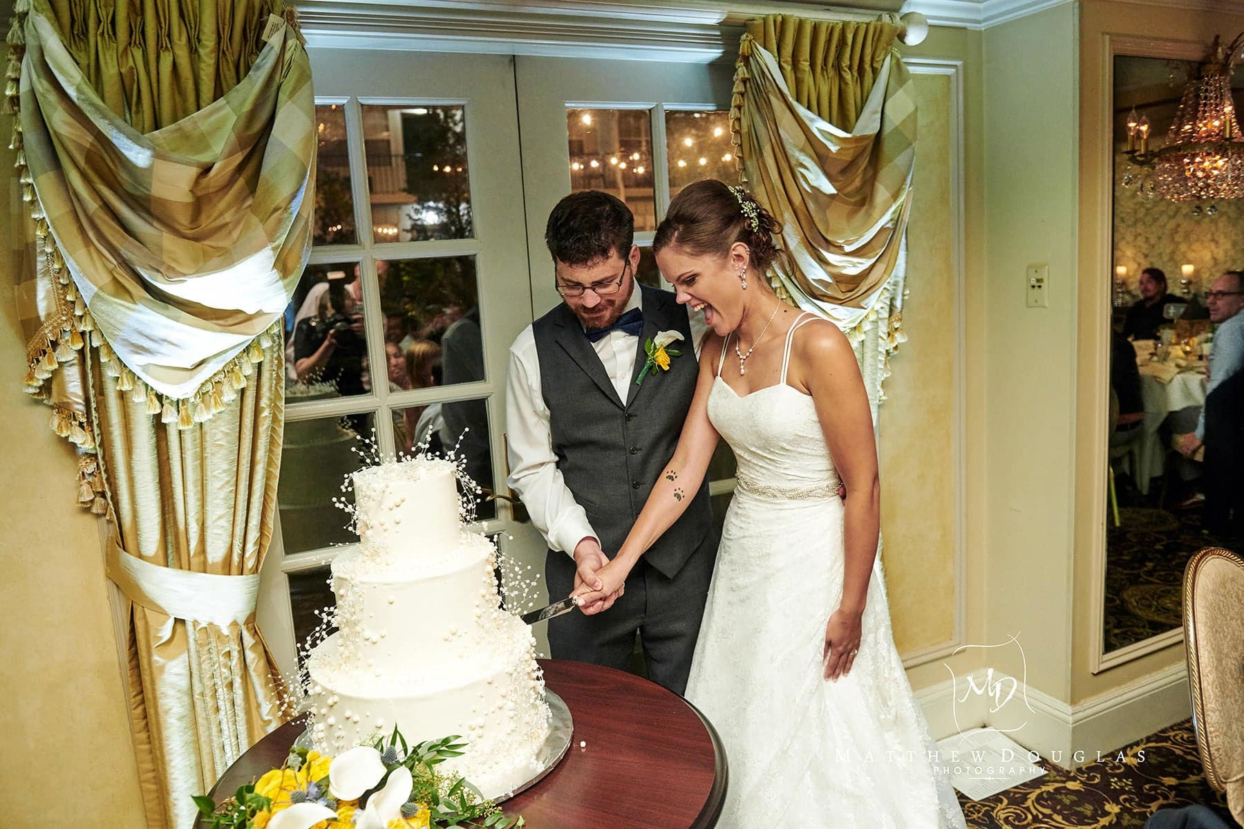 olde mill inn wedding cake cutting photo