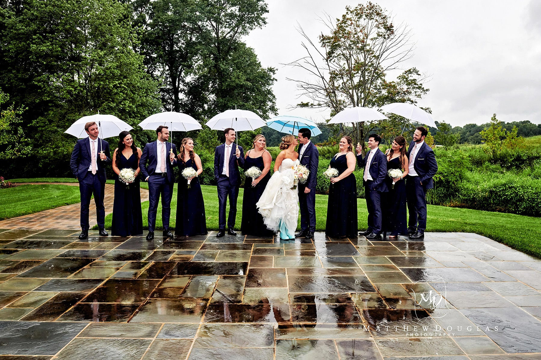 rainy day wedding bridal party photo