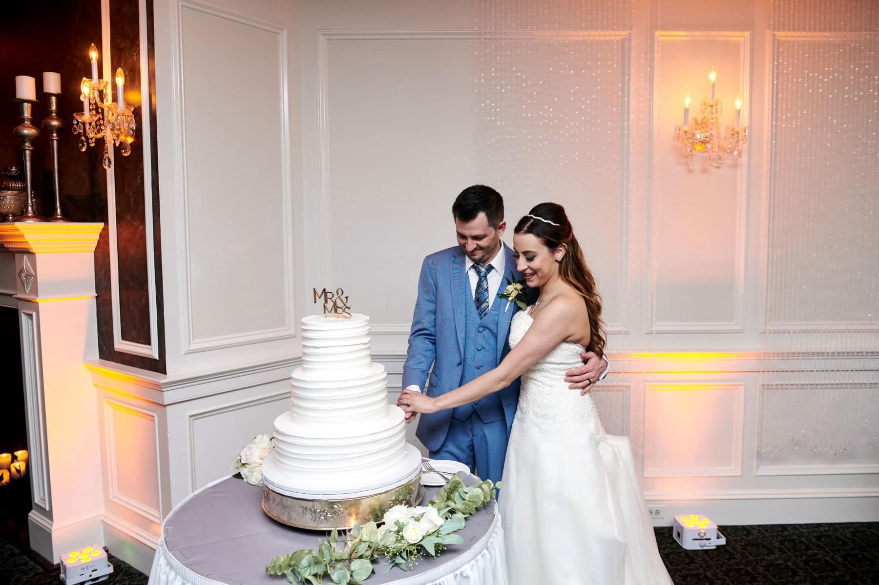 wedding cake cutting photo at basking ridge country club