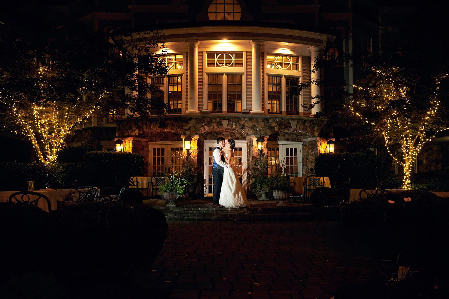 olde mill in wedding photo at night