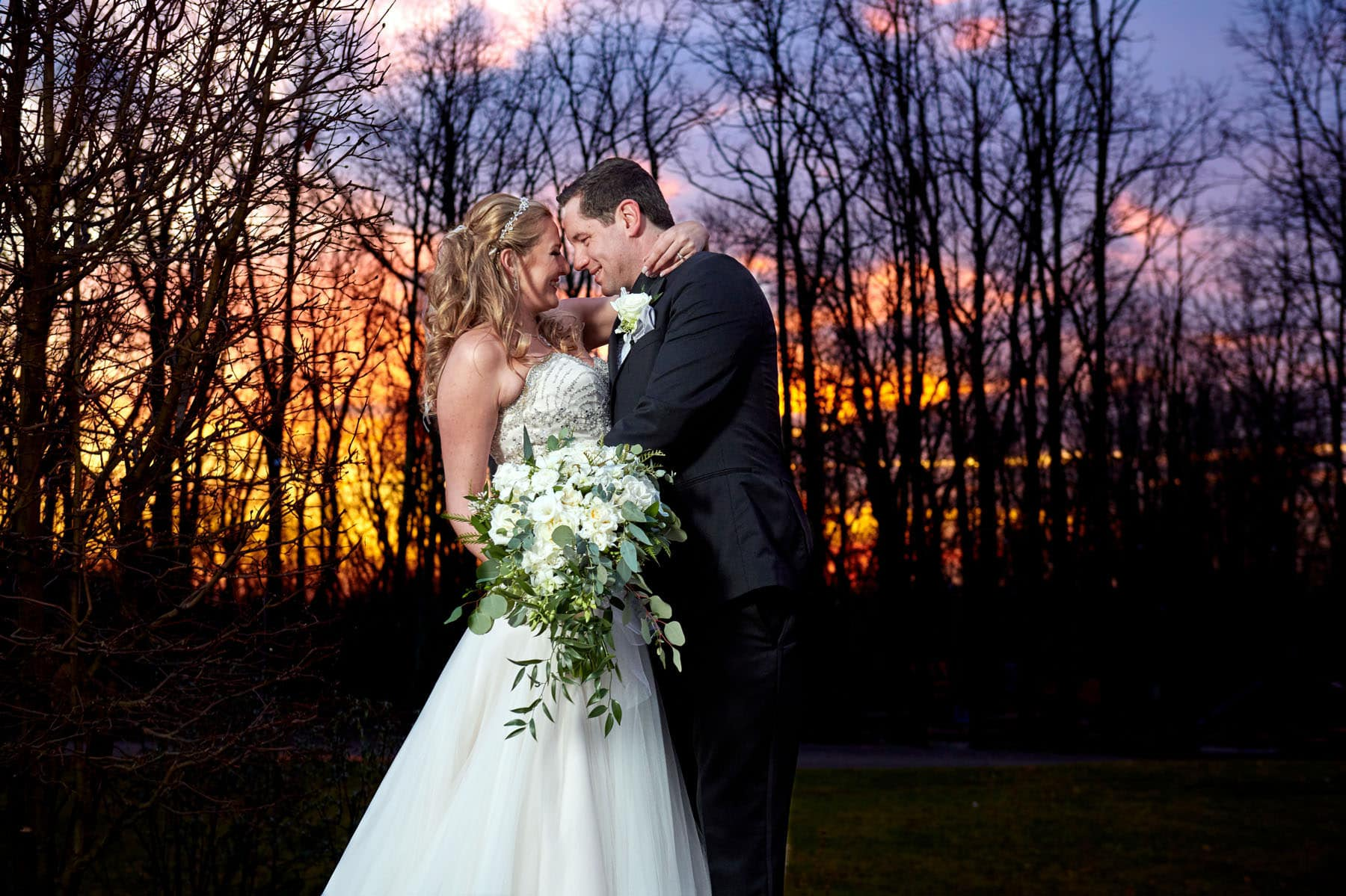 colorful sunset wedding photo at laurita winery