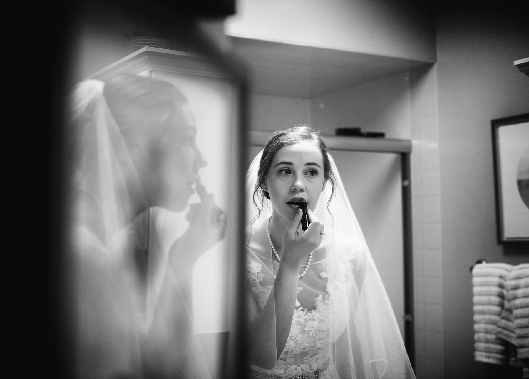 B+W photo of bride getting ready