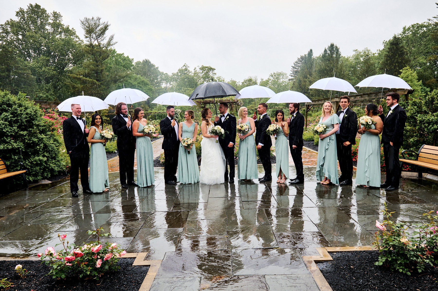 bridal party photo in the rain colonial park rose garden