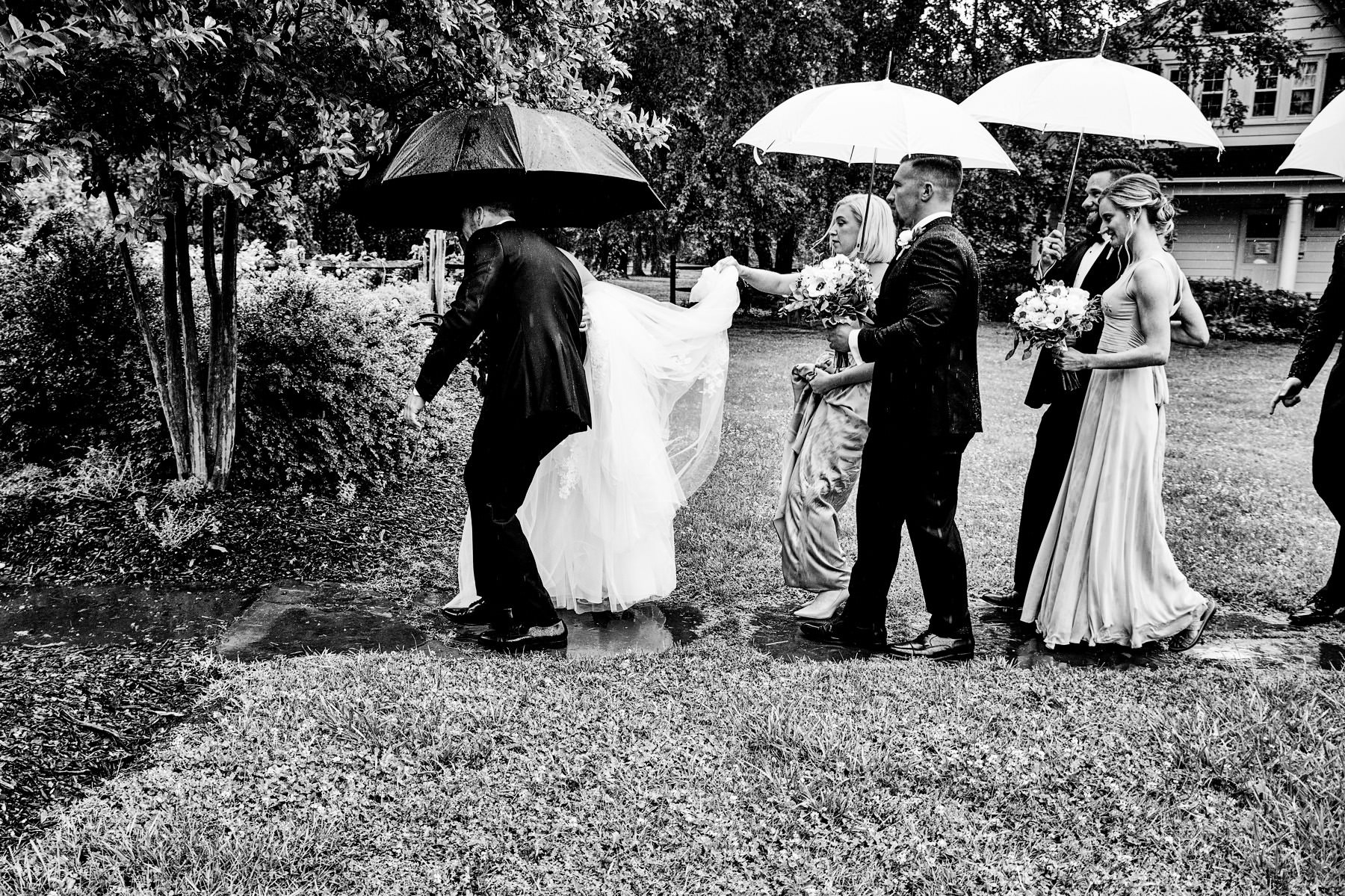 bridal party walking in the rain