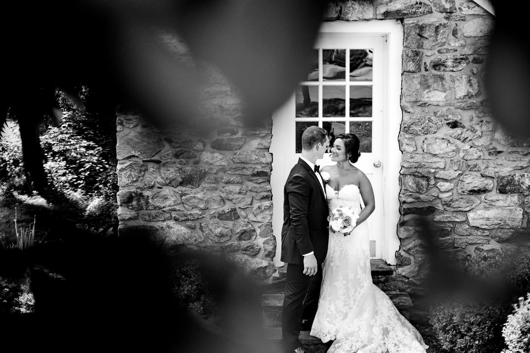 bride and groom at The Farmhouse school house on their wedding day