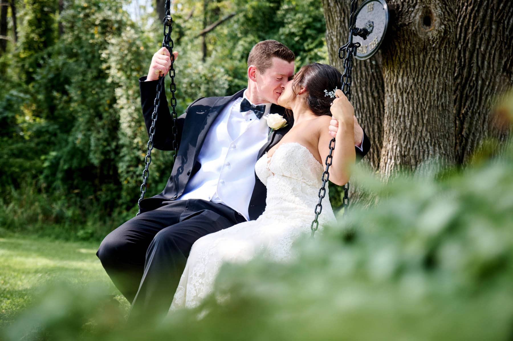 bride and groom on the swing at The Farmhouse